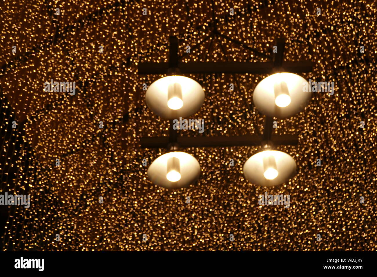 Close Up Of Illuminated Pendant Lights Hanging From Ceiling Stock Photo Alamy