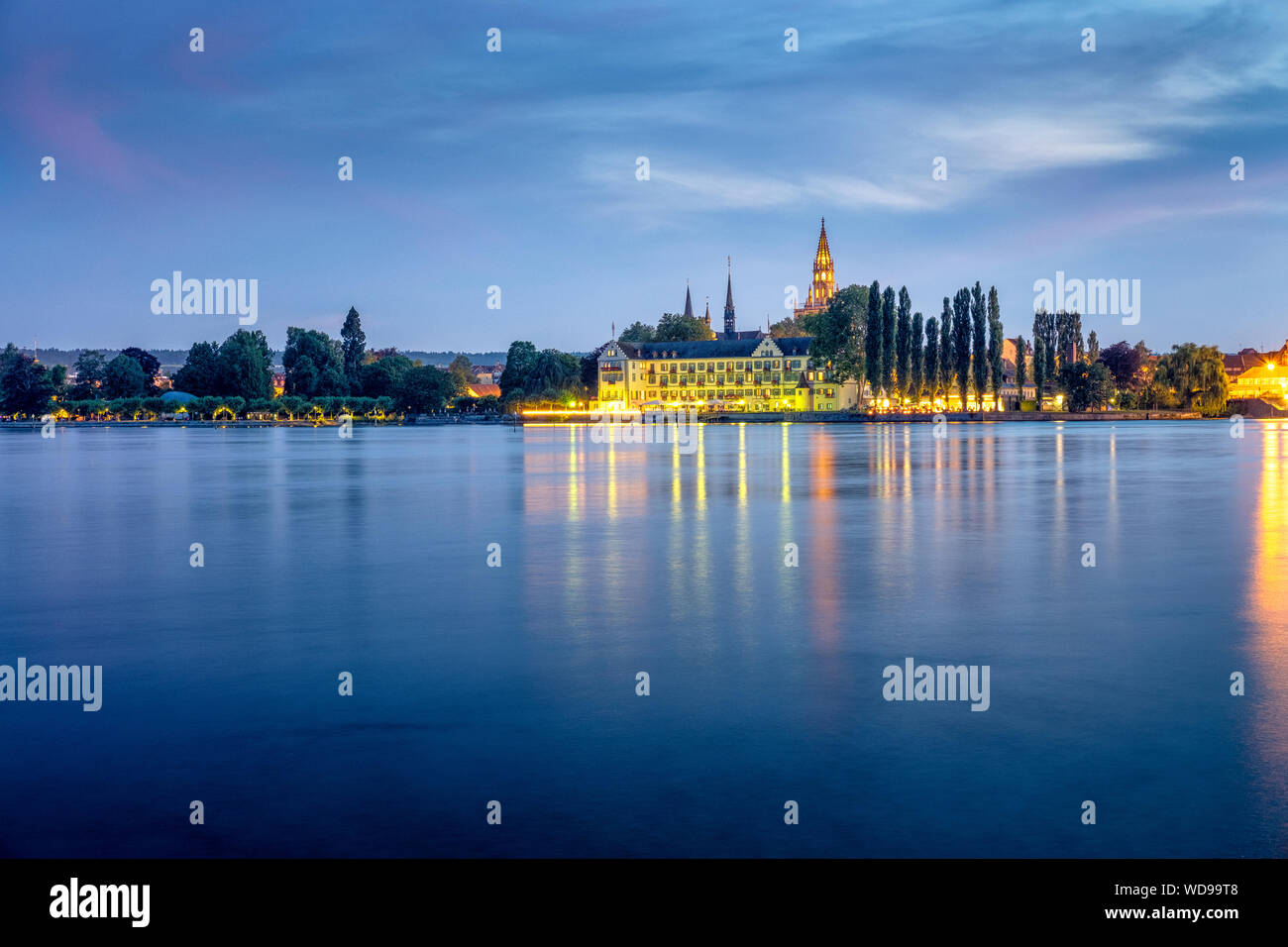 Konstanz, Germany- Lake Constance, Bodensee at night. View towards old town Niederburg  with Steigenberger Inselhotel and the gothic tower on Constanc Stock Photo