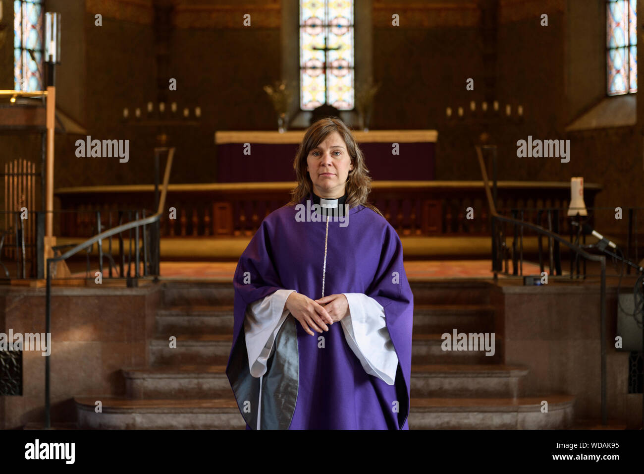 Portrait Of Priest In Purple Robes In Church Stock Photo Alamy