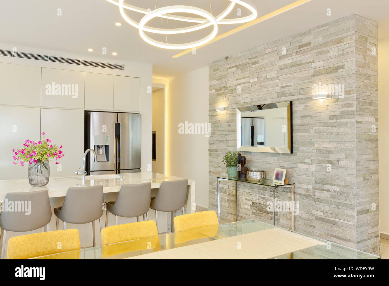 Modern Design Of Luxury White Kitchen With Marble Island And Dinner Table Stock Photo Alamy