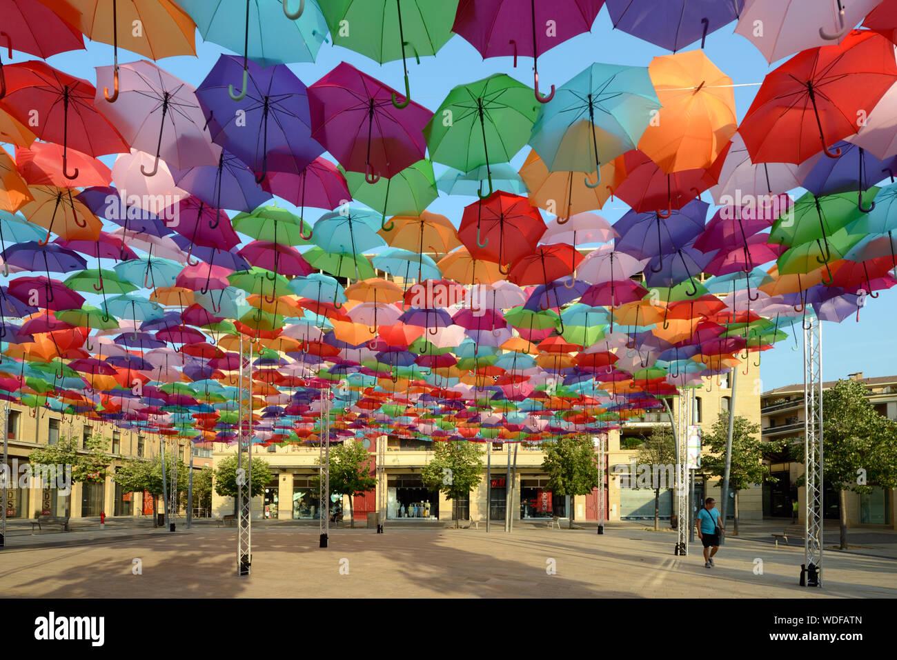 Colourful Parasols or Umbrellas Hanging Above Place Francois Villon, by Artist Patricia Cunha Umbrella Sky Project Art Installation Aix-en-Provence Stock Photo