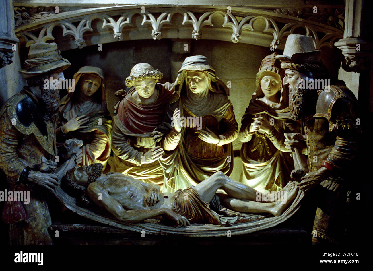 NOTRE DAME LA GRANDE POITIERS FRANCE - ENTOMBMENT REALISED BY UNKNOWN ARTIST 1555 - POLYCHROMY STATUE  - ROMANESQUE CHURCH - MISE AU TOMBEAU À NOTRE-DAME-LA-GRANDE POITIERS - SILVER IMAGE © Frédéric BEAUMONT Stock Photo