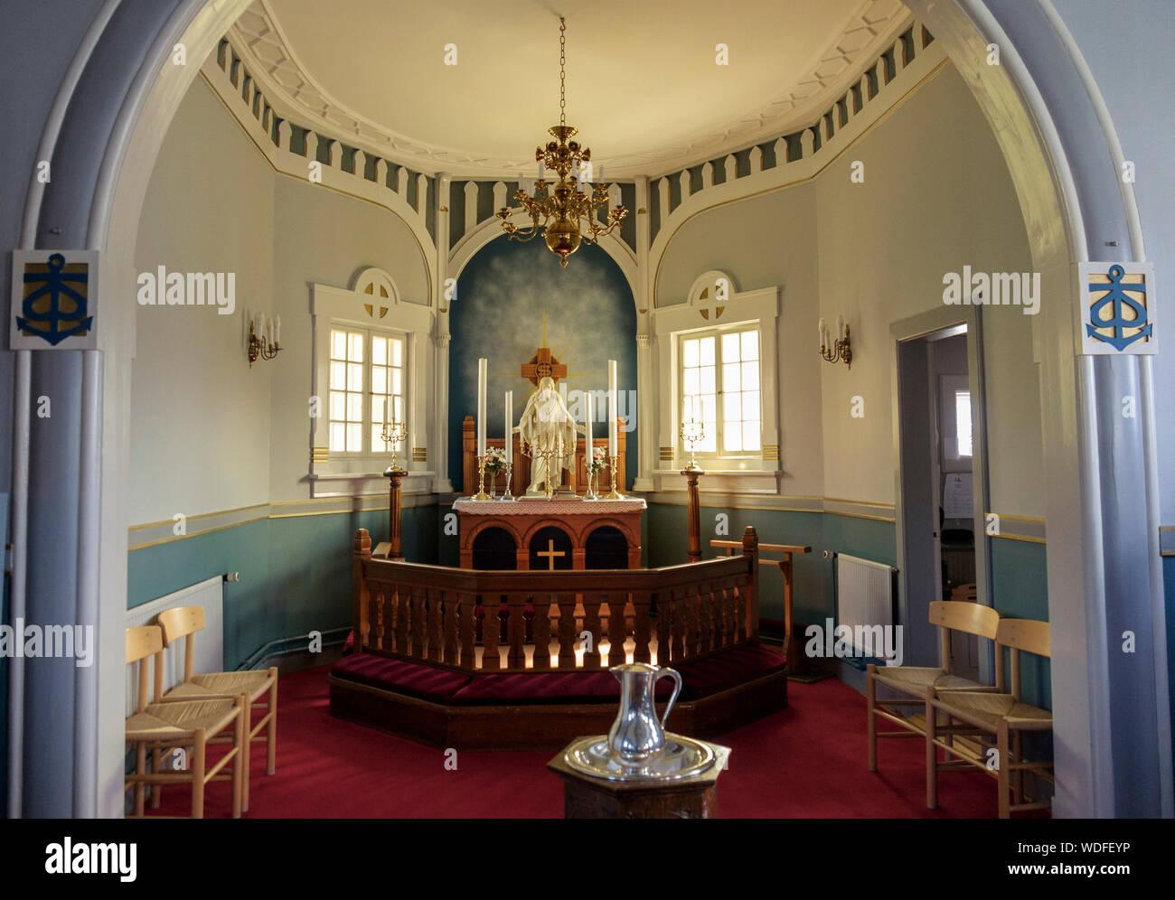 Altar inside the wooden church built in Norwegian style 1909. Paamiut (Frederikshåb), Sermersooq, Greenland Stock Photo
