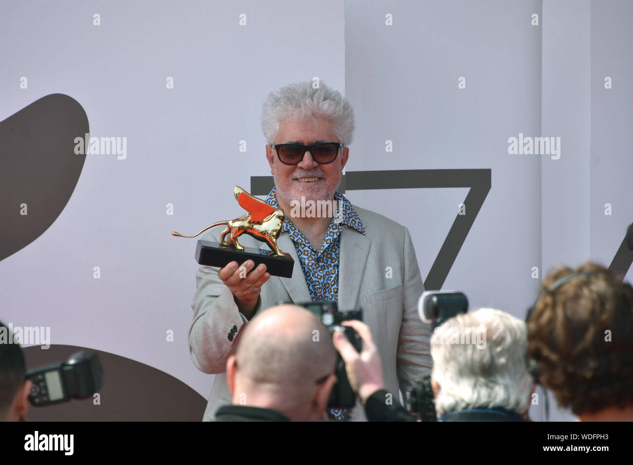 VENICE, Italy. 29th Aug, 2019. Pedro Almodovar shows the Golden Lion at Palazzo del Cinema after receiving it for lifetime achievements during the 76th Venice Film Festival on August 29, 2019 in Venice, Italy. Credit: Andrea Merola/Awakening/Alamy Live News Stock Photo