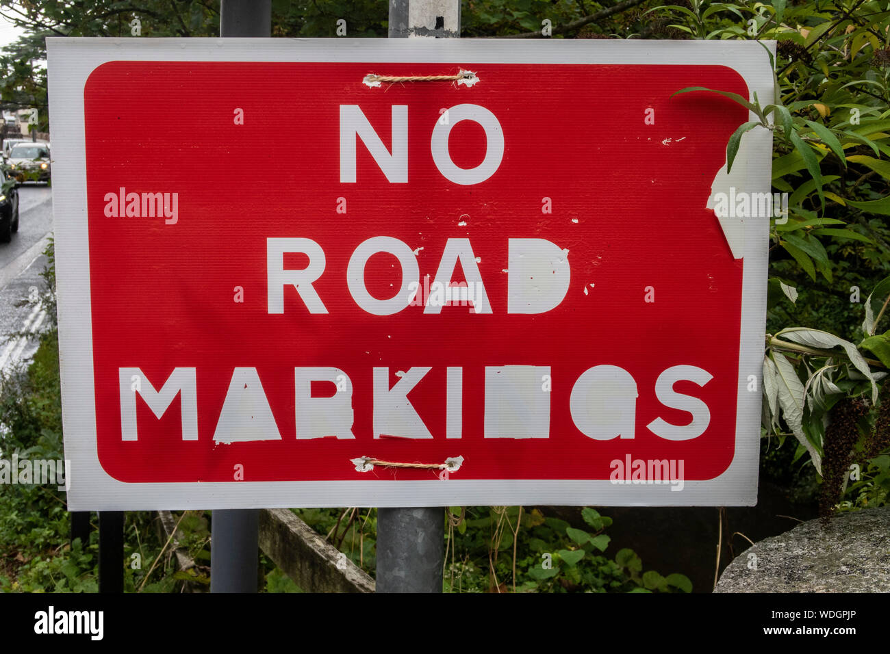 """Almost illegible sign saying """"No road markings"""". Stock Photo"""