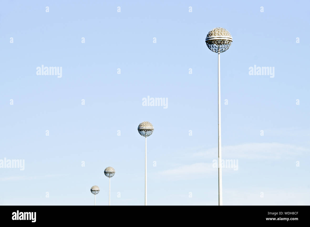 Low Angle View Of Floodlights Against Sky On Sunny Day At San Siro Stadium Stock Photo