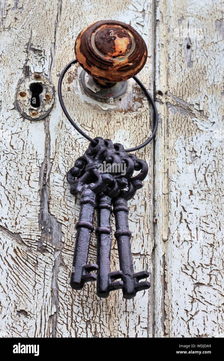 vintage orange old clock key gold tassel blue gray Skeleton key on ornate tassle antique