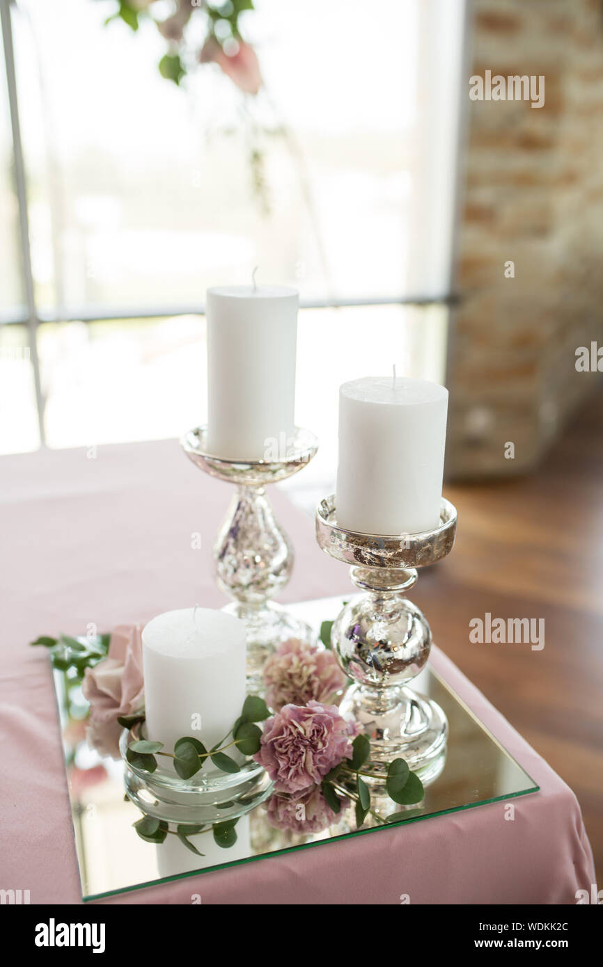 The Wedding Table Setting For The Newlyweds Is Decorated With Fresh Flowers Of Carnation Rose Anthurium And Eucalyptus Leaves Silver Candlesticks Stock Photo Alamy