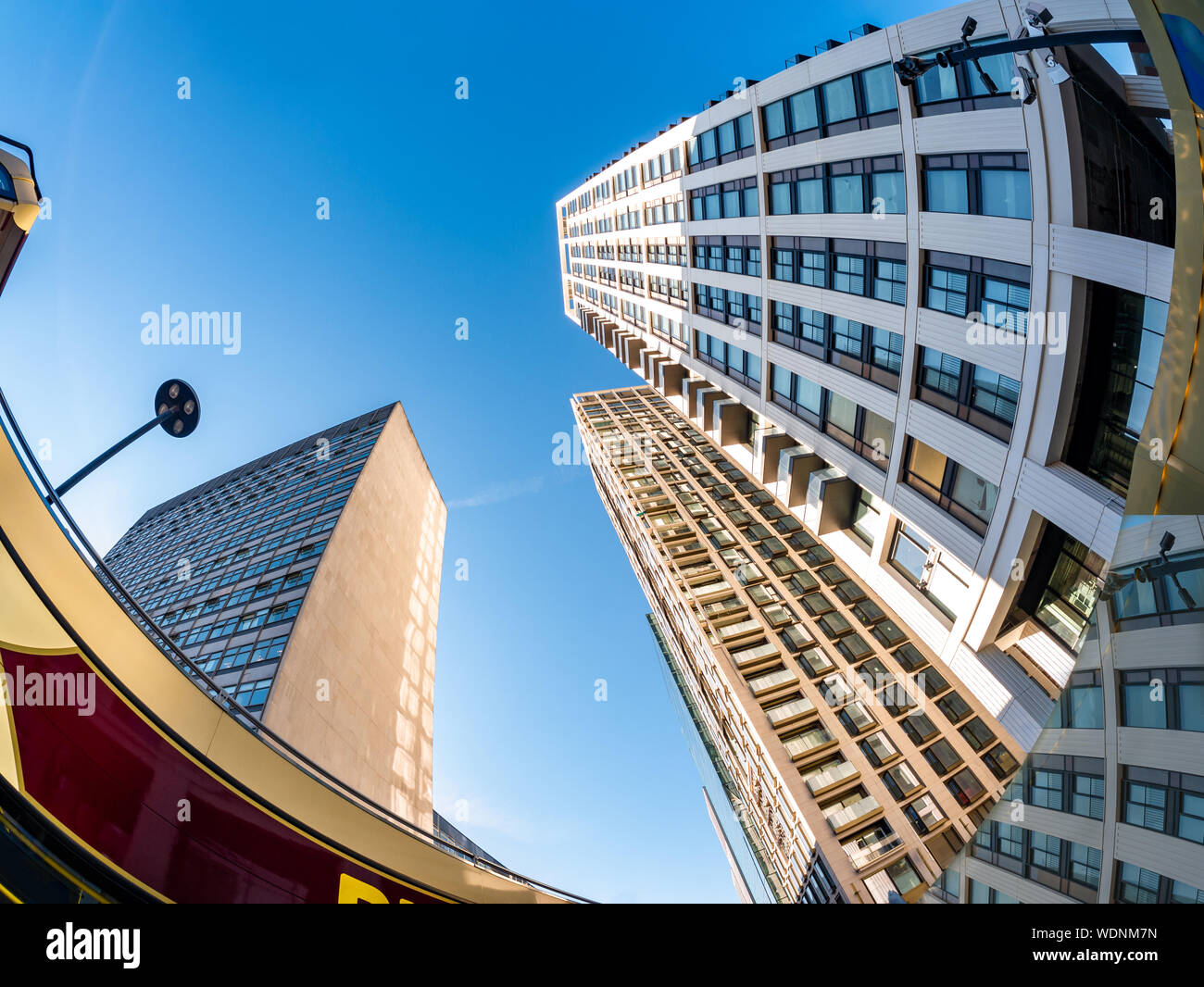Wide angle view of tall buildings in the City of London against blue sky in England Stock Photo