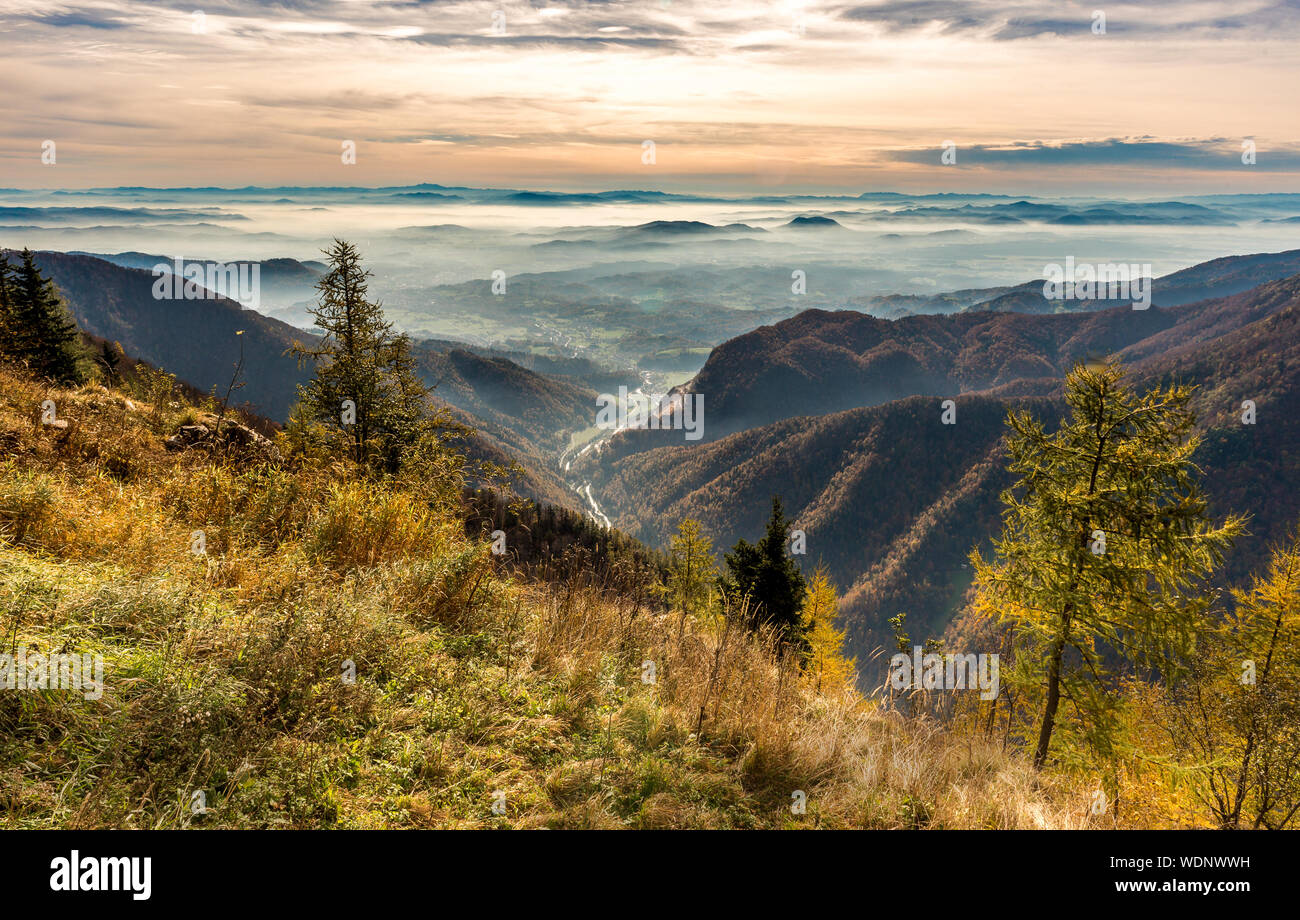 Scenic View Of Landscape Against Sky During Sunset Stock Photo