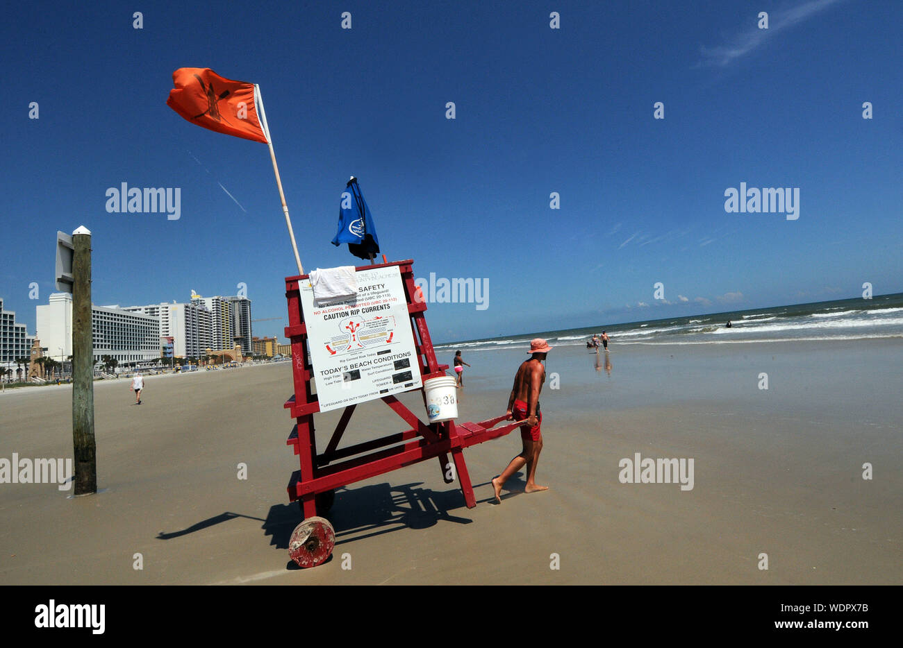 Titusville, FL, USA. 29th Aug, 2019. A lifeguard moves his chair on a calm and quiet beach several days ahead of the Hurricane Dorian which is expected to become a Category 4 hurricane before making landfall in Florida on Labor Day. Credit: Paul Hennessy/SOPA Images/ZUMA Wire/Alamy Live News Stock Photo