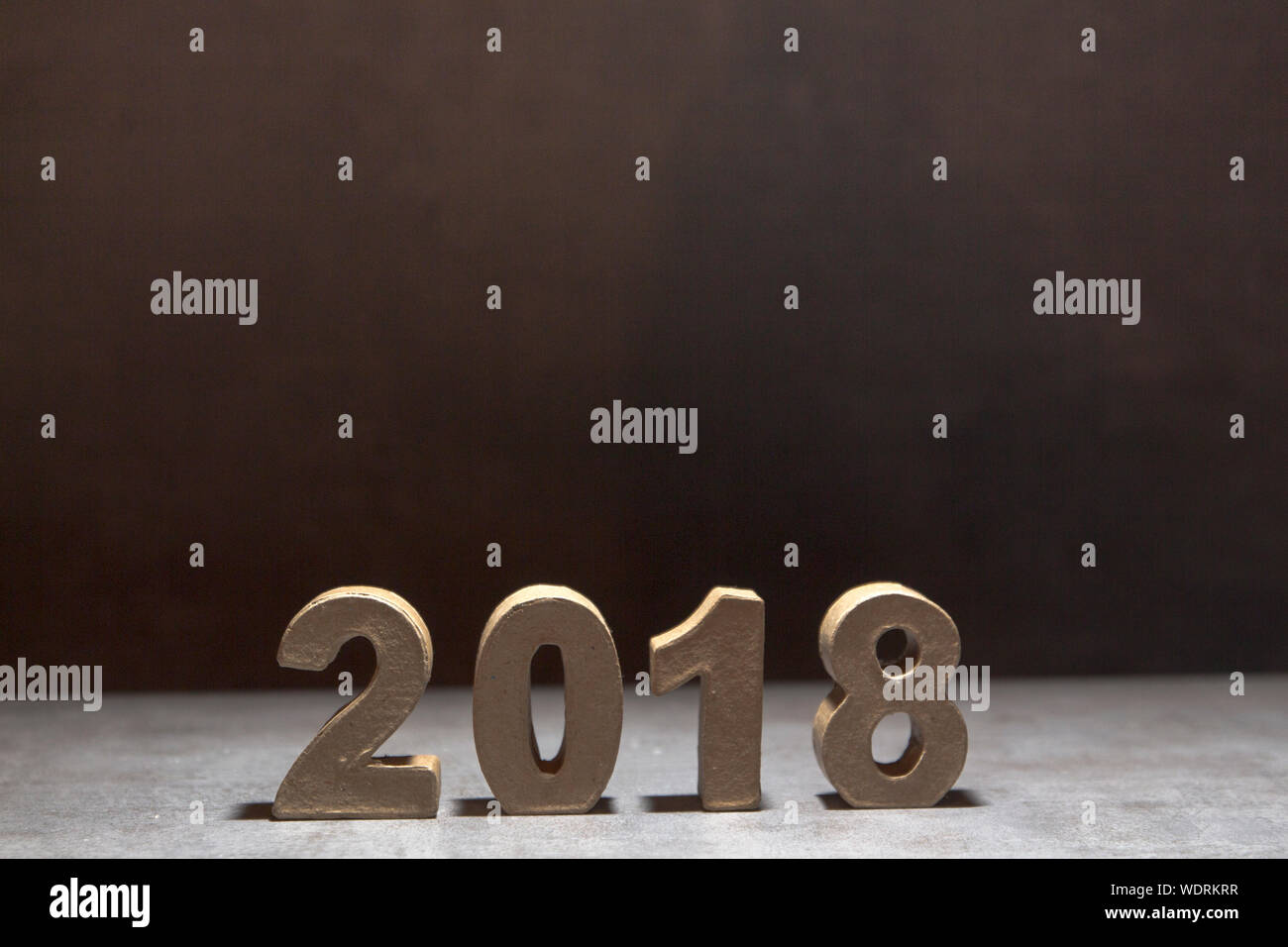Close-up Of 2018 On Table Against Black Background Stock Photo
