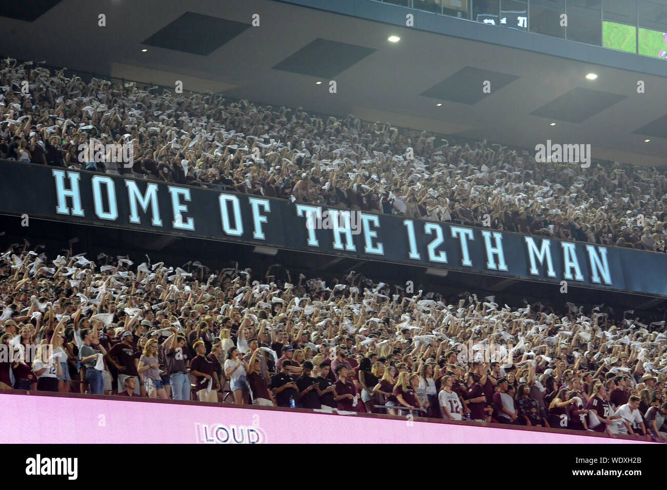 College Station, Texas, USA. 29th Aug, 2019. August 29, 2019: Texas A&M Aggies fans waving their rally flags on 3rd down during the game between the Texas State University Bobcats and the Texas A&M University Aggies at Kyle Field Stadium in College Station, TX. Texas A&M Aggies leads the first half against Texas State Bobcats, 28-0. Patrick Green/CSM Credit: Cal Sport Media/Alamy Live News Stock Photo