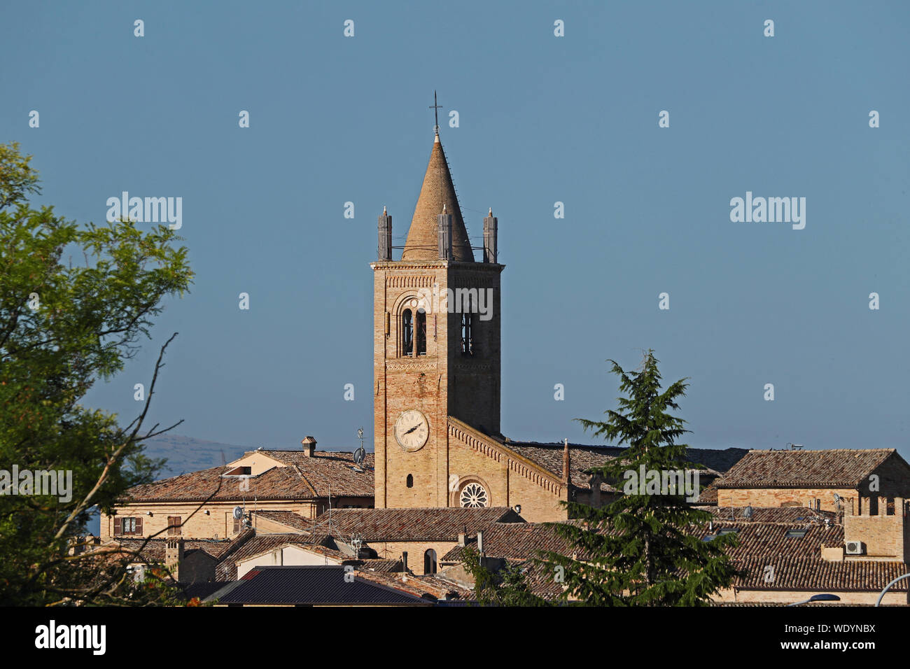 shored up clock tower on the church in the Medieval village of Montecassiano  in the Marches or Le Marche region of Italy after the 2016 earthquake Stock Photo