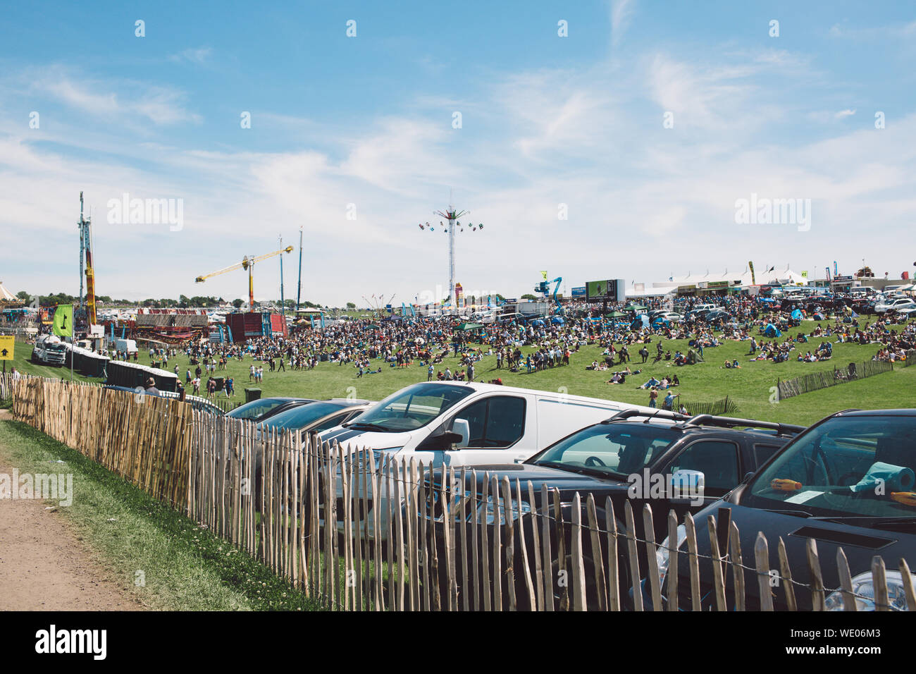 Cars Parked By Fence At Epsom Downs Racecourse Against Sky Stock Photo