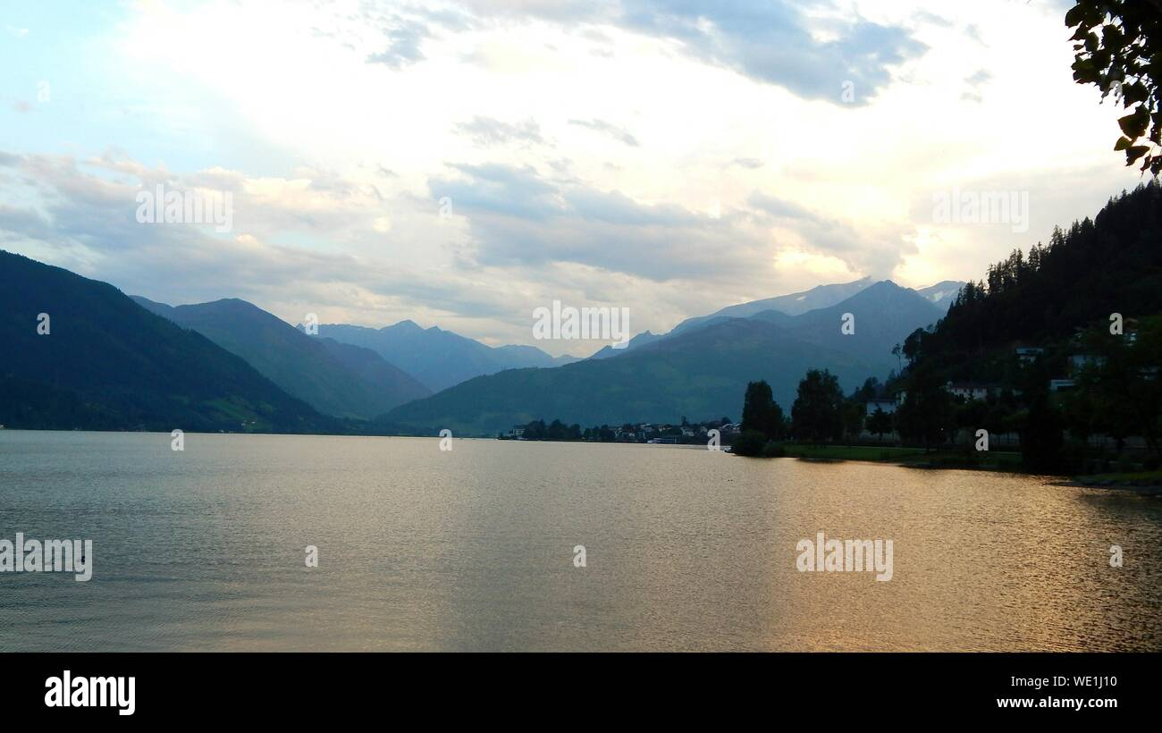 Scenic View Of Lake By Mountains Against Sky Stock Photo