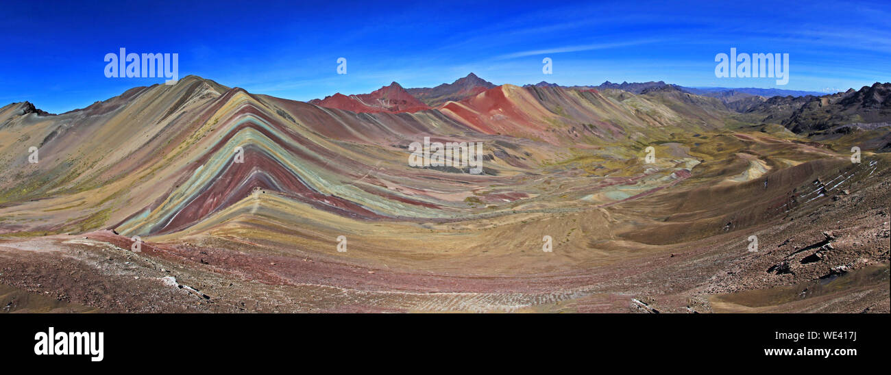 The total panorama of the beautiful colored Rainbow Mountain, near Cusco in the peruvian mountains. Located about 20km south of Ausangate mountain. Stock Photo