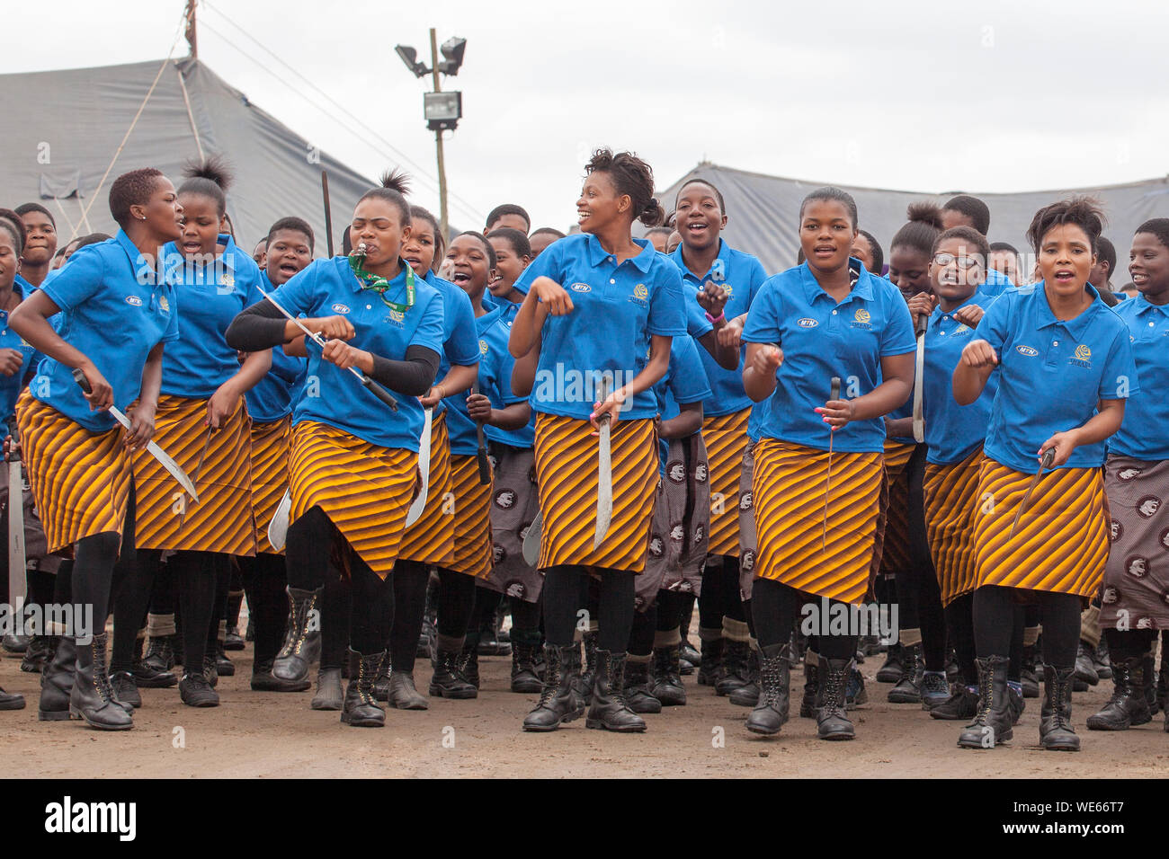 Mbabane, Swaziland - August 31, 2017: Umhlanga Reed Dance ceremony traditional rite young virgin girls with big knives machete go to field to cut reed Stock Photo