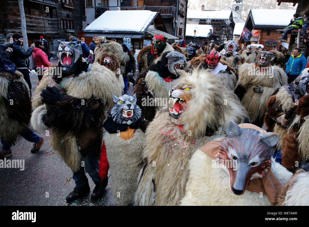 Switzerland, Valais Canton, Val d'Herens, village of Evolene, Carnaval, peluches disguisment of young people and children dressed with a coat made of animal fur and a carved traditional wooden mask made in the village representing mythical animals Stock Photo