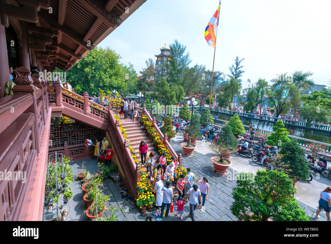 Architecture temple in  morning lunar new year decorated flowers front yard attracted  Buddhists visit cultural spiritual in Ho Chi Minh, Vietnam Stock Photo
