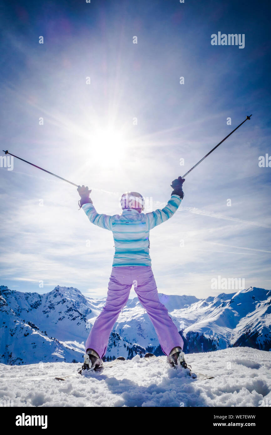 Rear View Of Woman Standing On Snow Covered Mountain Against Sky Stock Photo