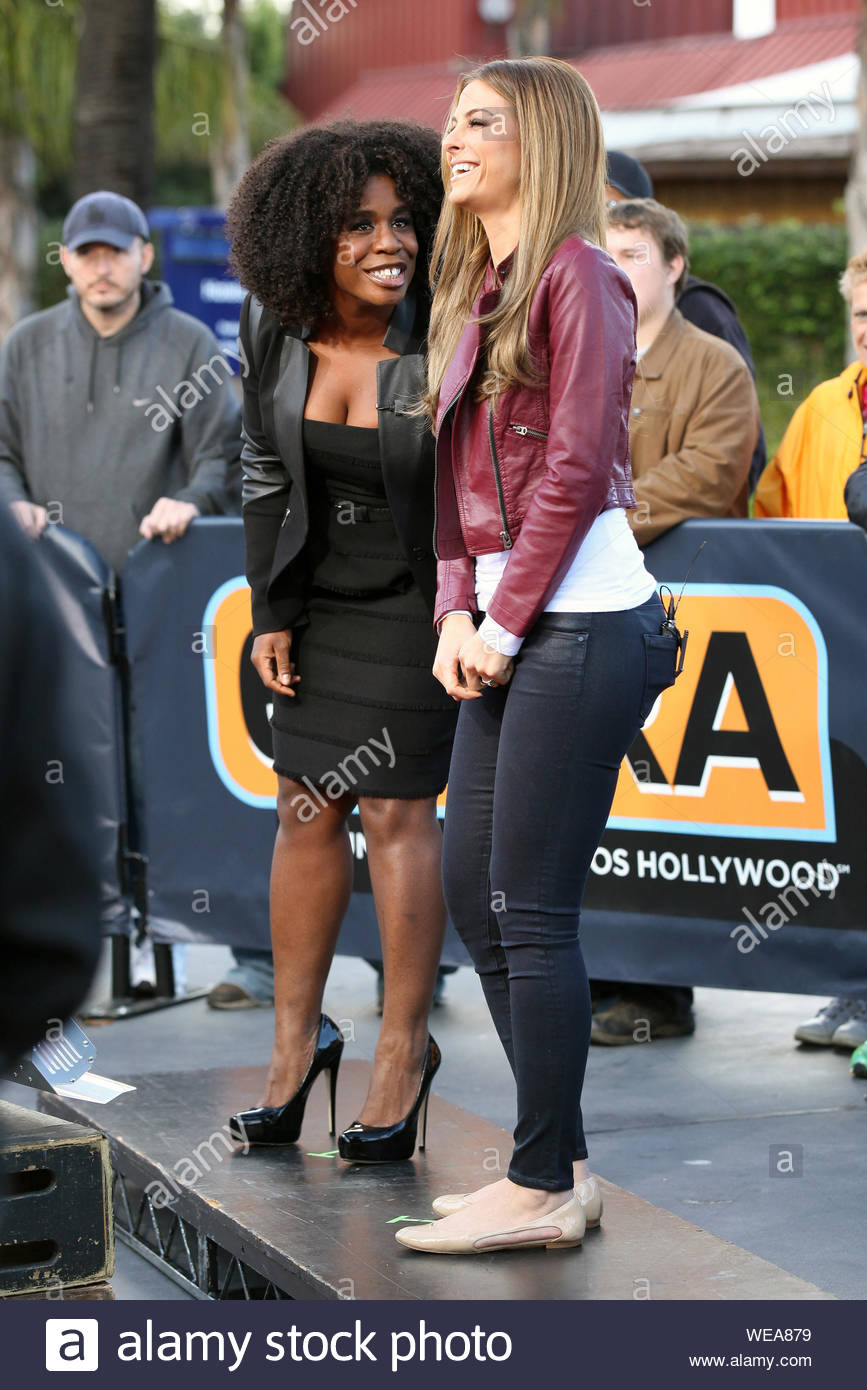 Universal City Ca Uzo Aduba Entertains Maria Menounos On The Extra Stage At Universal Studios In Universal City Uzo Aduba Is An American Actress Of Nigerian Extraction She Is Known For