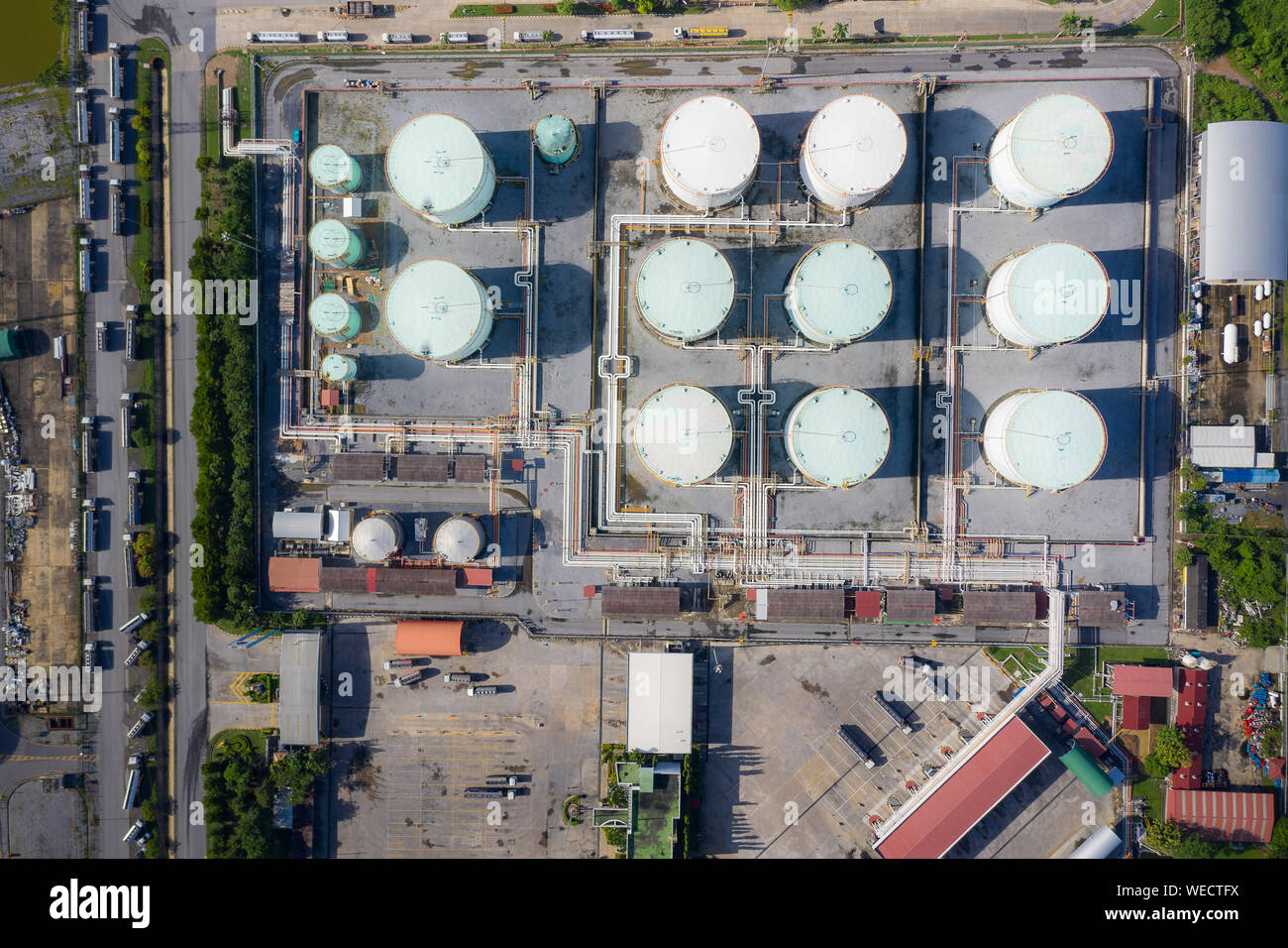 Aerial view of Chemical industry storage tank and tanker truck In wailting in Industrial Plant to tranfer oil to gas station. Stock Photo