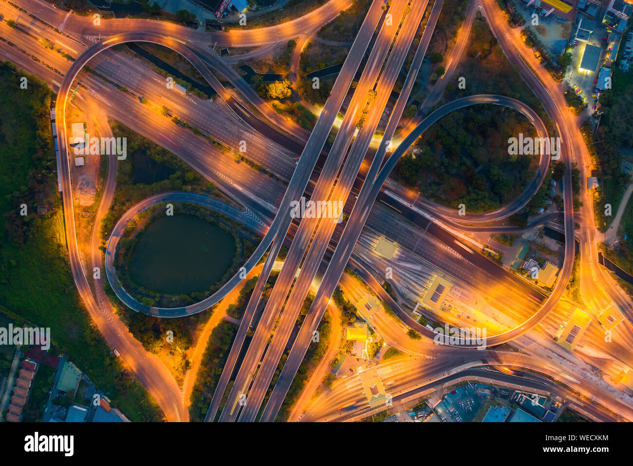 Aerial View Above of Busy Highway Road Junctions at day. The Intersecting Freeway Road Overpass The Eastern Outer Ring Road of Bangkok. Stock Photo