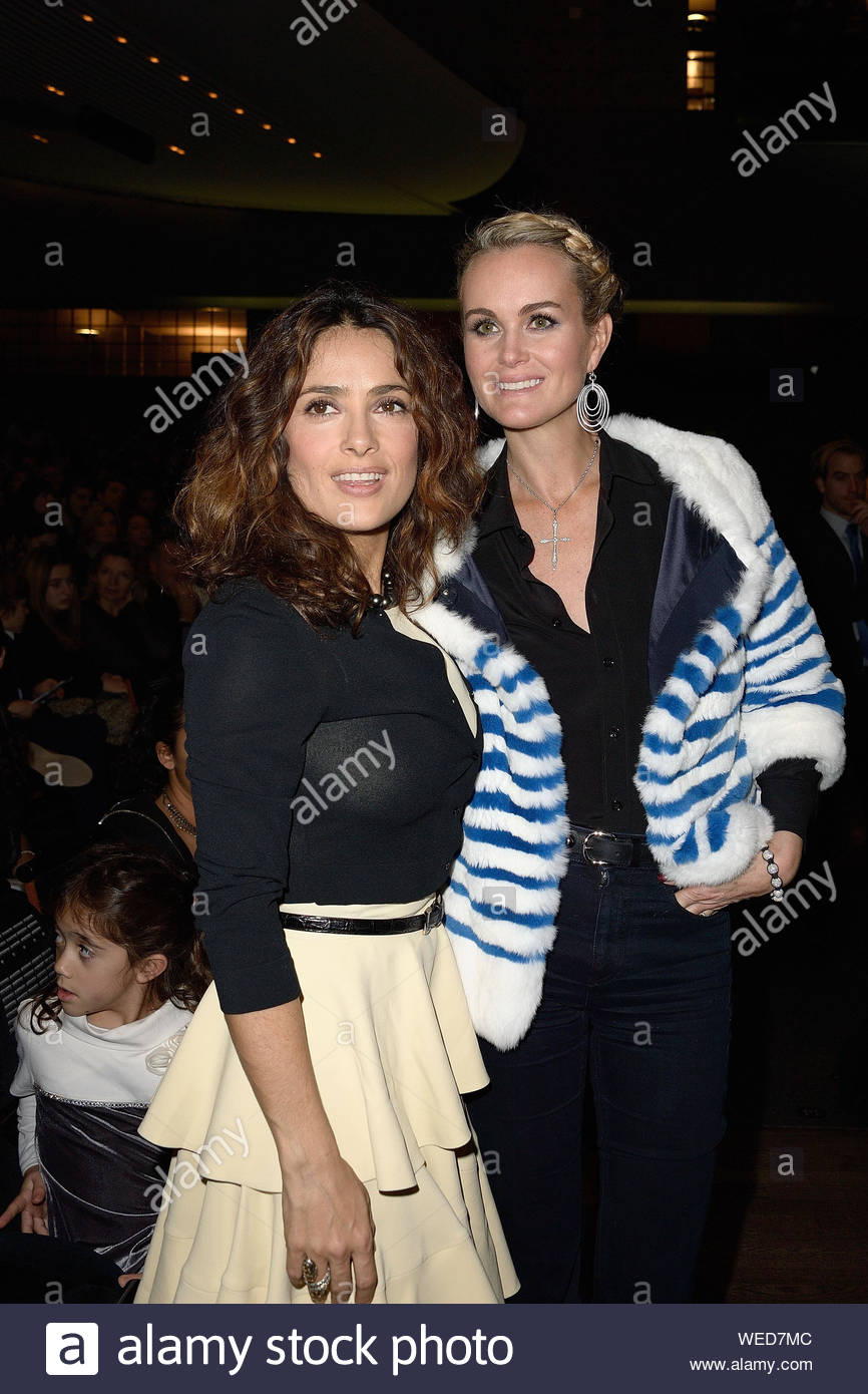 "Paris, France - Salma Hayek and Laeticia Hallyday at the ""Reves d'Enfants"" Arop charity event held at Opera Bastille in Paris. AKM-GSI December 15, 2013 Stock Photo"