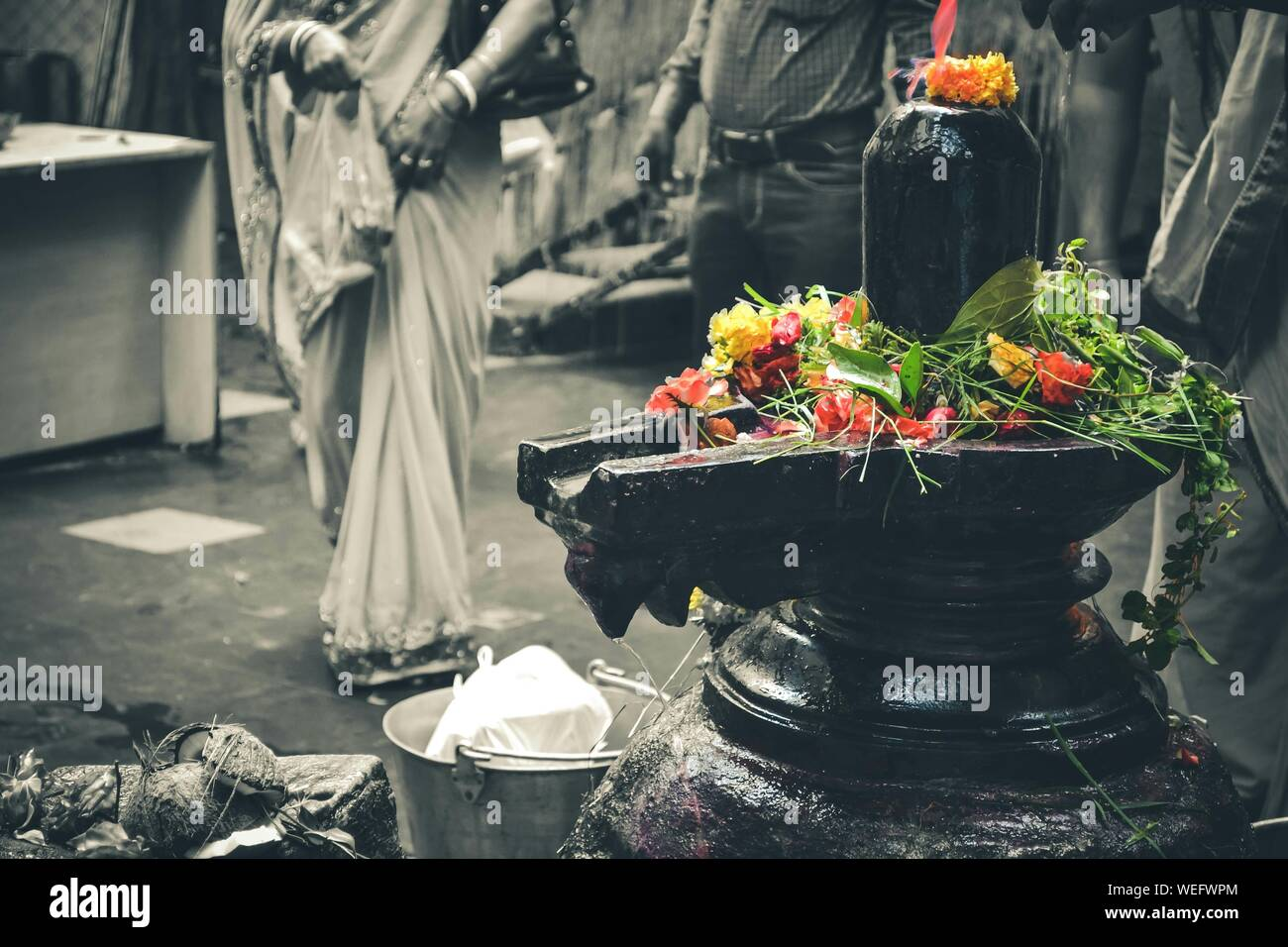 shiva linga high resolution stock photography and images alamy https www alamy com close up of shiva linga with flowers in temple image267110220 html