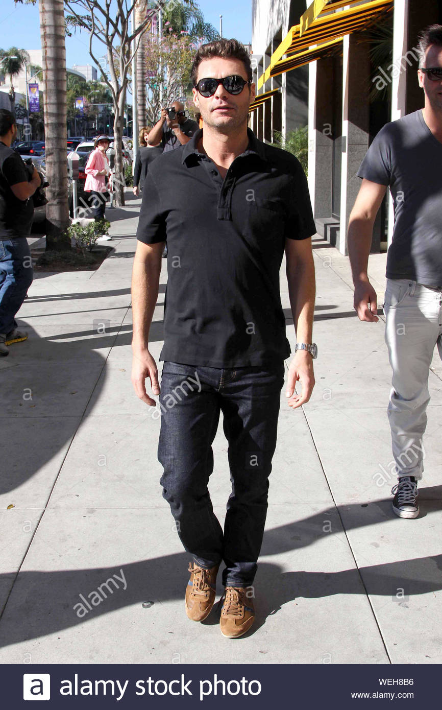 ryan seacrest black and white sneakers