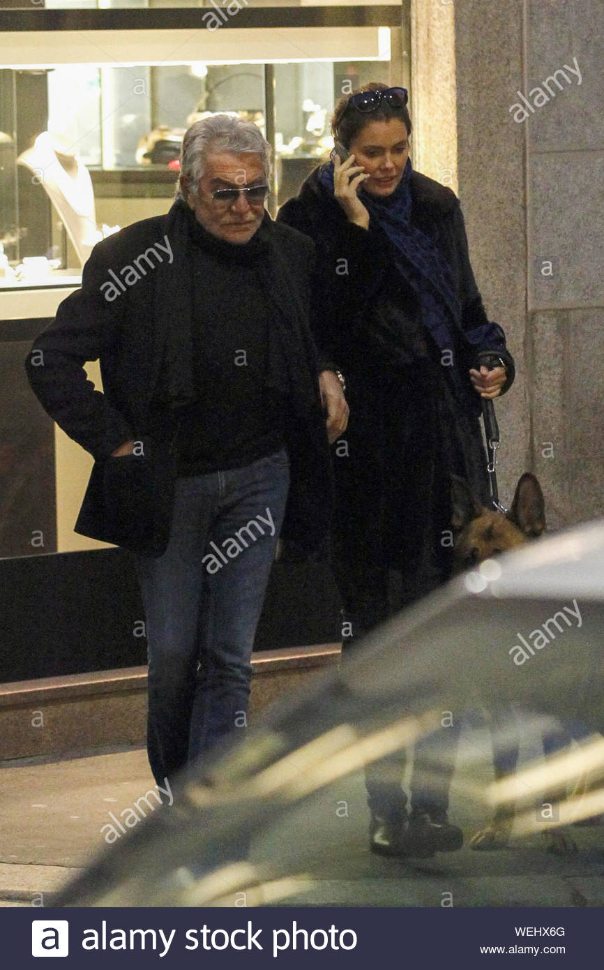 Milan Italy Italian Fashion Designer Roberto Cavalli And His Young And Beautiful Girlfriend Lina Nilson Take A Romantic Stroll In Downtown Milan With Their Dog The Three Walked Around Until Sundown
