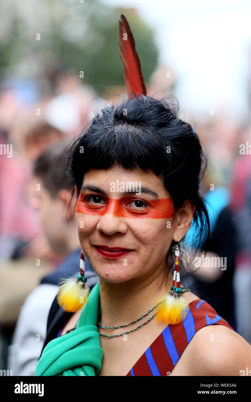 Manchester, UK. 30th August, 2019. Mexican Veronica Castro joins climate change protesters who have occupied Deansgate, a major road through the city. The Northern rebellion gathering has been facilitated by Greater Manchester Police and will last until Monday.  The extinction rebellion protesters are raising awareness of the damage been caused to the planet by climate change. Deansgate, Manchester, UK. Credit: Barbara Cook/Alamy Live News Stock Photo