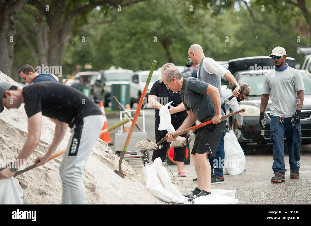 Fort Lauderdale, Florida, USA. 30th Aug, 2019. Residents of Fort Lauderdale line up to get sand bags distributed by the city of Fort Lauderdale in preperation for hurricane Dorian, in Fort Lauderdale, Fla. The hurricane is forecast to hit Florida as a major category 4 hurricane late Monday. Credit: Orit Ben-Ezzer/ZUMA Wire/Alamy Live News Stock Photo