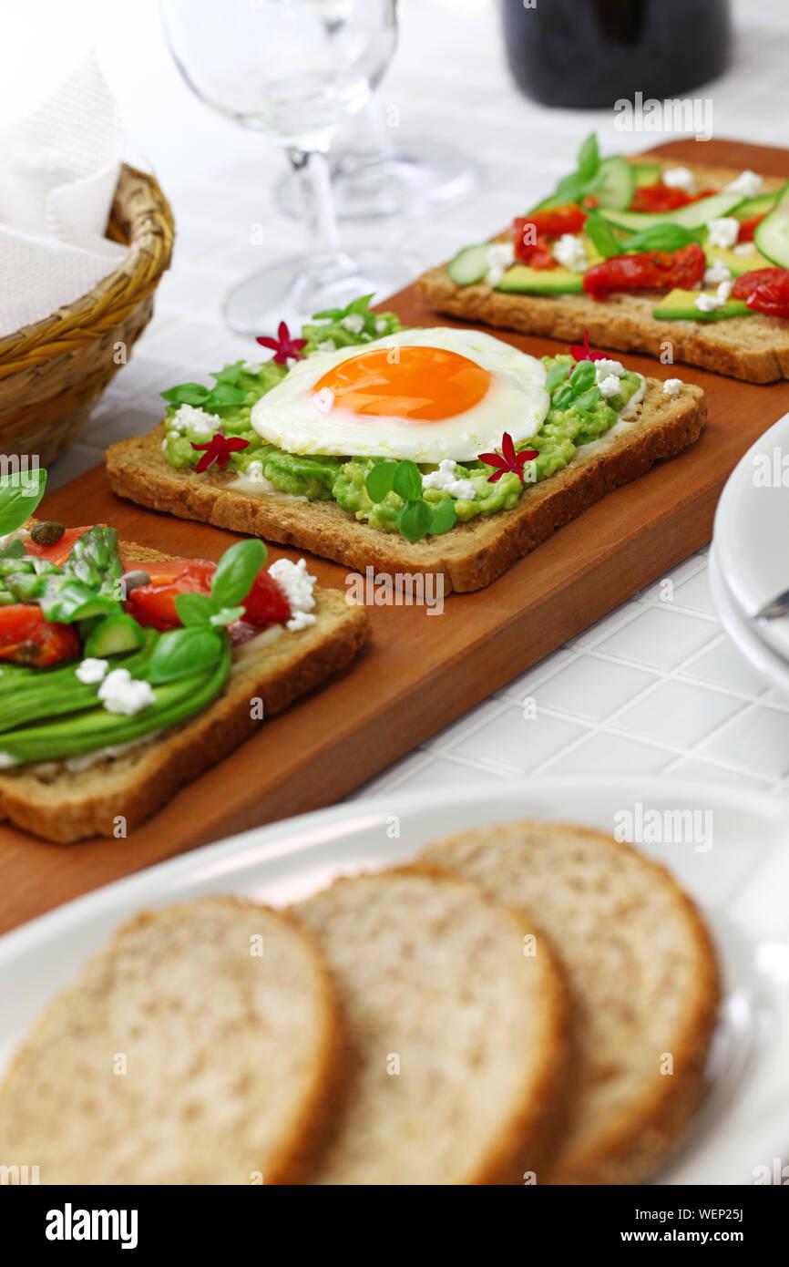 avocado toast open sandwich variety isolated on white background Stock Photo