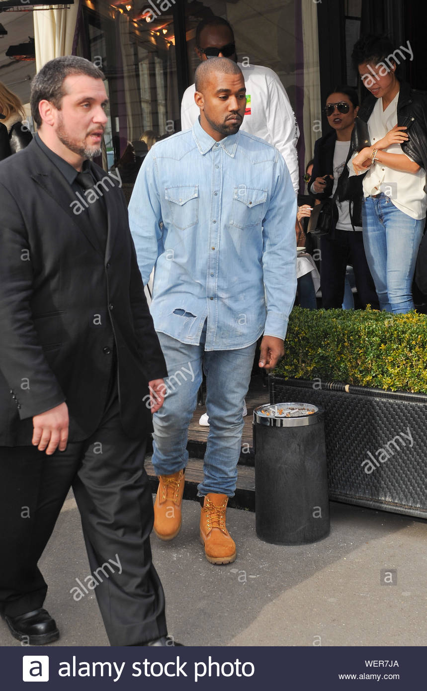 Paris France Rapper And Fashion Designer Kanye West Seen Exiting The Posh Restaurant L Avenue Akm Gsi March 2 2014 Stock Photo Alamy