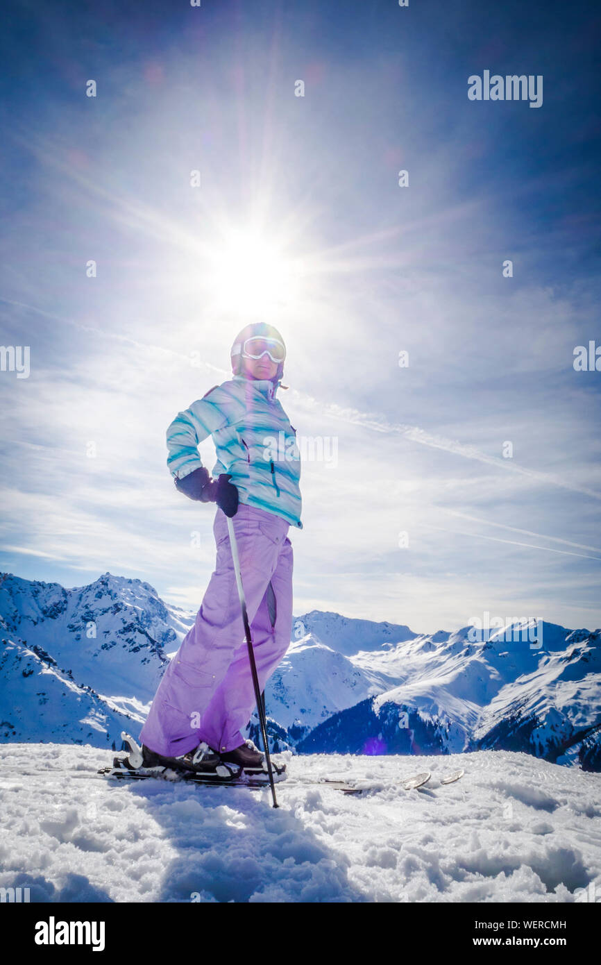Woman Skiing On Snowy Field During Sunny Day Stock Photo