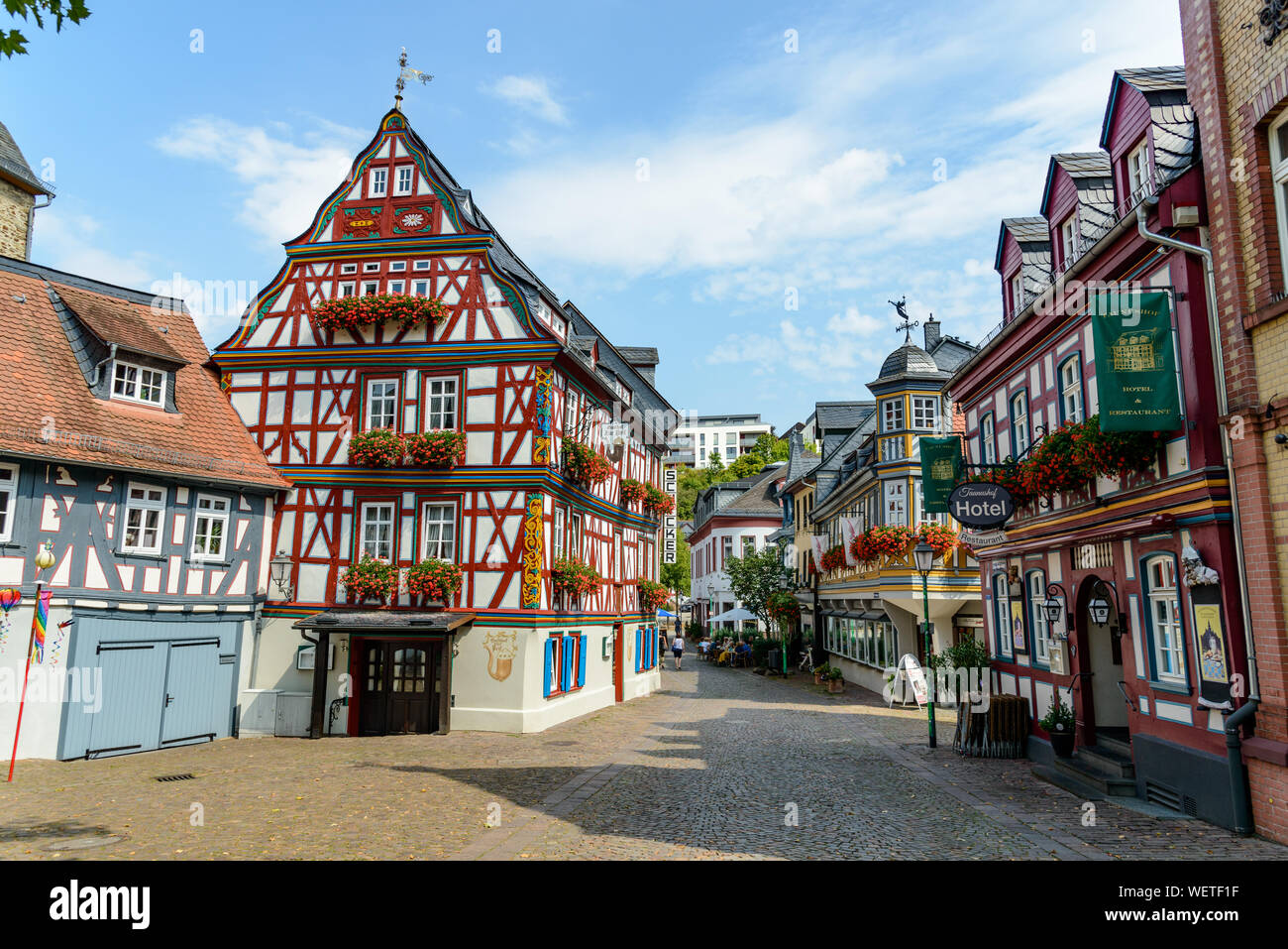 29 August 2019: Colorful Half-timbered (Fachwerkhaus) house, houses, Hotel, restaurant nearby marketplace in Idstein, Hessen (Hesse), Germany. Nearby Stock Photo