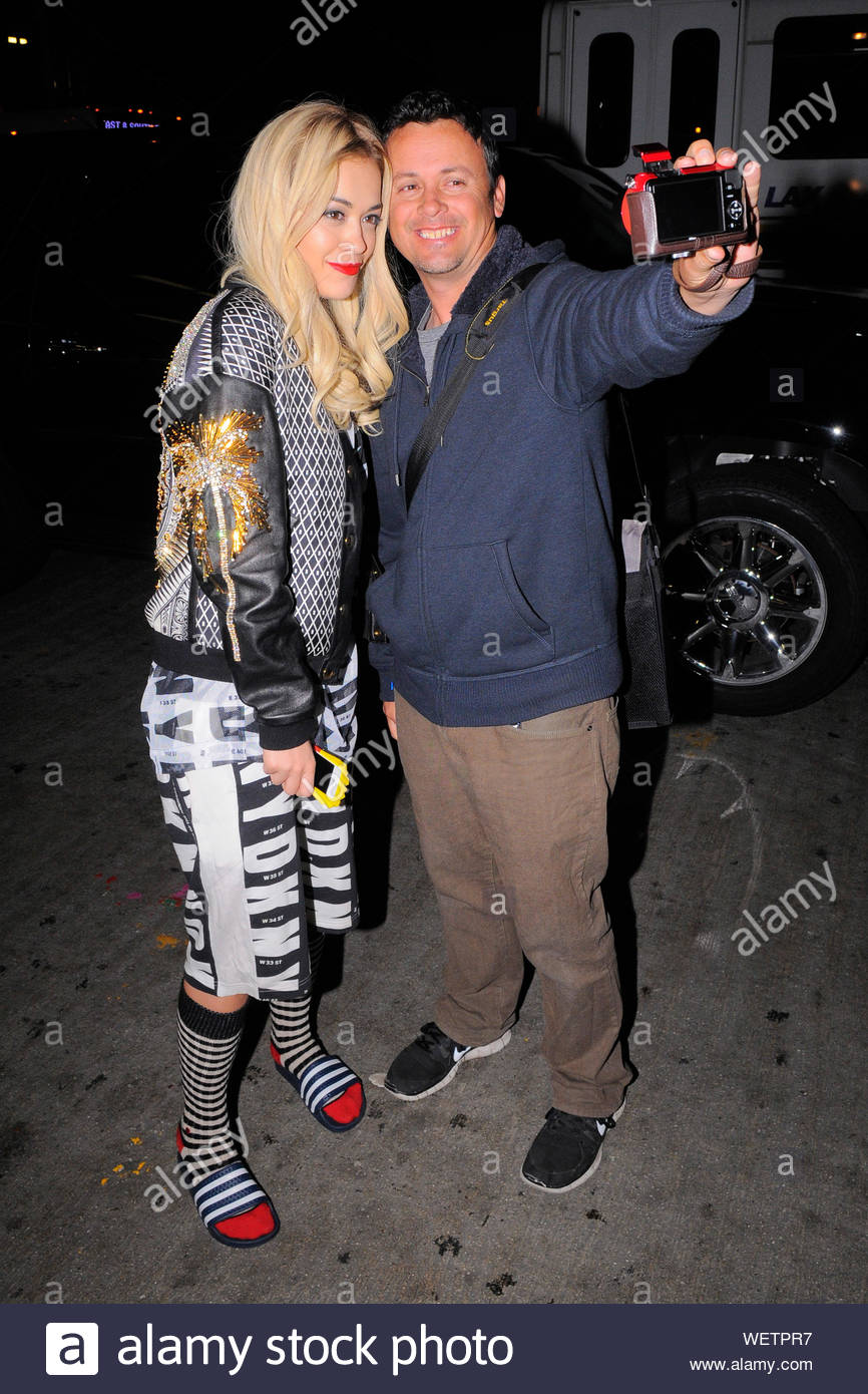 Los Angeles, CA - British singer-songwriter, actress and fashion model Rita Ora dons a monochromatic DKNY outfit as she arrives at LAX Airport to catch a late departing flight, Ora also posed with a few fans before heading inside the Terminal. AKM-GSI March 10, 2014 Stock Photo