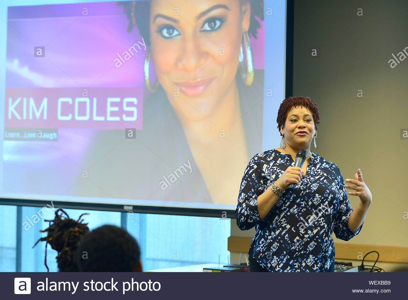 "Davie, FL - Actress and Comedian Kim Coles speaks and sign copies of her book ""Gratitude Journal Choose to Live Life Out Loud"" to discuss her story of gratitude, Intention, forgiveness, triumphs and self-love in the library at Broward Community College on March 18, 2014 in Davie, Florida. The lecture is titled ""Love and Laughter: Identity, Acceptance, and the Female World of Comedy"". AKM-GSI March 18, 2014 Stock Photo"