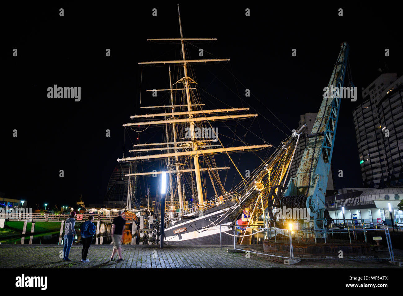 """Bremerhaven, Germany. 31st Aug, 2019. The historic sailing ship """"Seute Deern"""" has fallen into a sloping position due to a pump failure. When troops of the fire brigade explored the """"Seute Deern"""", the ship tilted so threateningly that the mission was aborted. The """"Seute Deern"""" (High German """"Sweet Girl"""") belongs to the museum fleet of the German Maritime Museum (DSM) and has been located in the Old Harbour for more than 50 years. Credit: Mohssen Assanimoghaddam/dpa/Alamy Live News Stock Photo"""