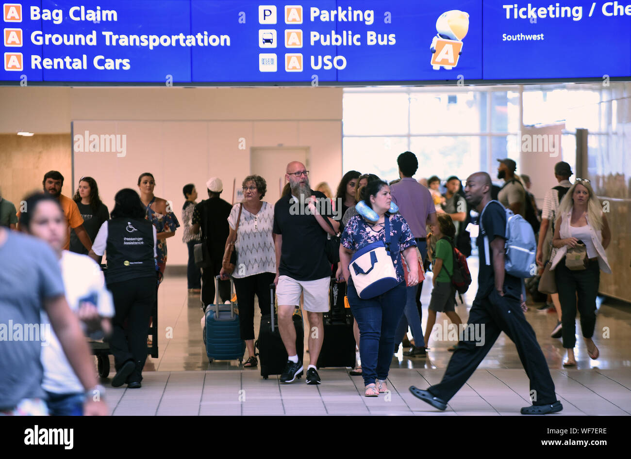 Orlando, Florida, USA. 30th Aug, 2019. Passengers arrive at Orlando International Airport for departing flights ahead of the arrival of Hurricane Dorian, which has intensified to Category 4 and which will threaten parts of the Bahamas and the Southeastern U.S. over Labor Day weekend. Credit: Paul Hennessy/SOPA Images/ZUMA Wire/Alamy Live News Stock Photo