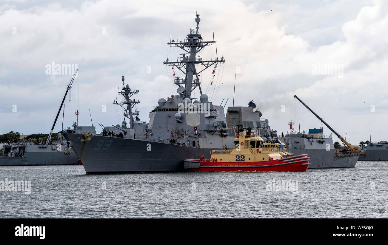 190830-N-QI061-4250  JACKSONVILLE, Fla. (Aug. 30, 2019) The Arleigh Burke-class guided-missile destroyer USS Farragut (DDG 99) departs from Naval Station Mayport as Commander, U.S. 4th Fleet orders all U.S. Navy ships homeported in the area to sortie ahead of Hurricane Dorian, which is forecasted to bring high winds and heavy rain to the East Coast. Ships are being directed to areas in the Atlantic where they are best postured for storm avoidance. (U.S. Navy photo by Mass Communication Specialist 3rd Class Nathan T. Beard/Released) Stock Photo