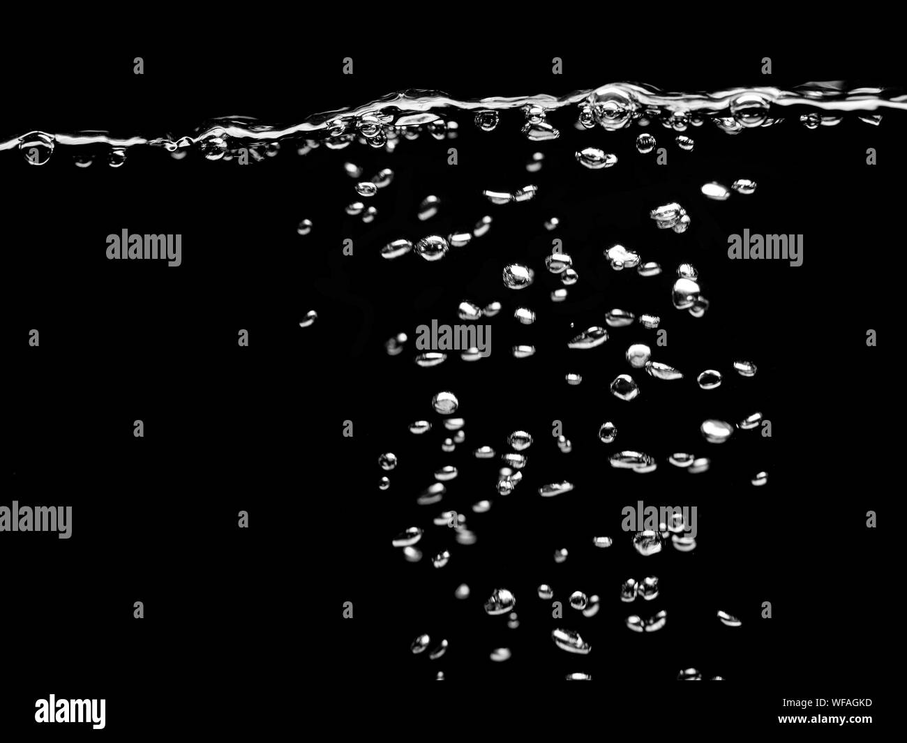 water drops bubbles on a dark background, Bubbles in the water, Effervescent drink Stock Photo
