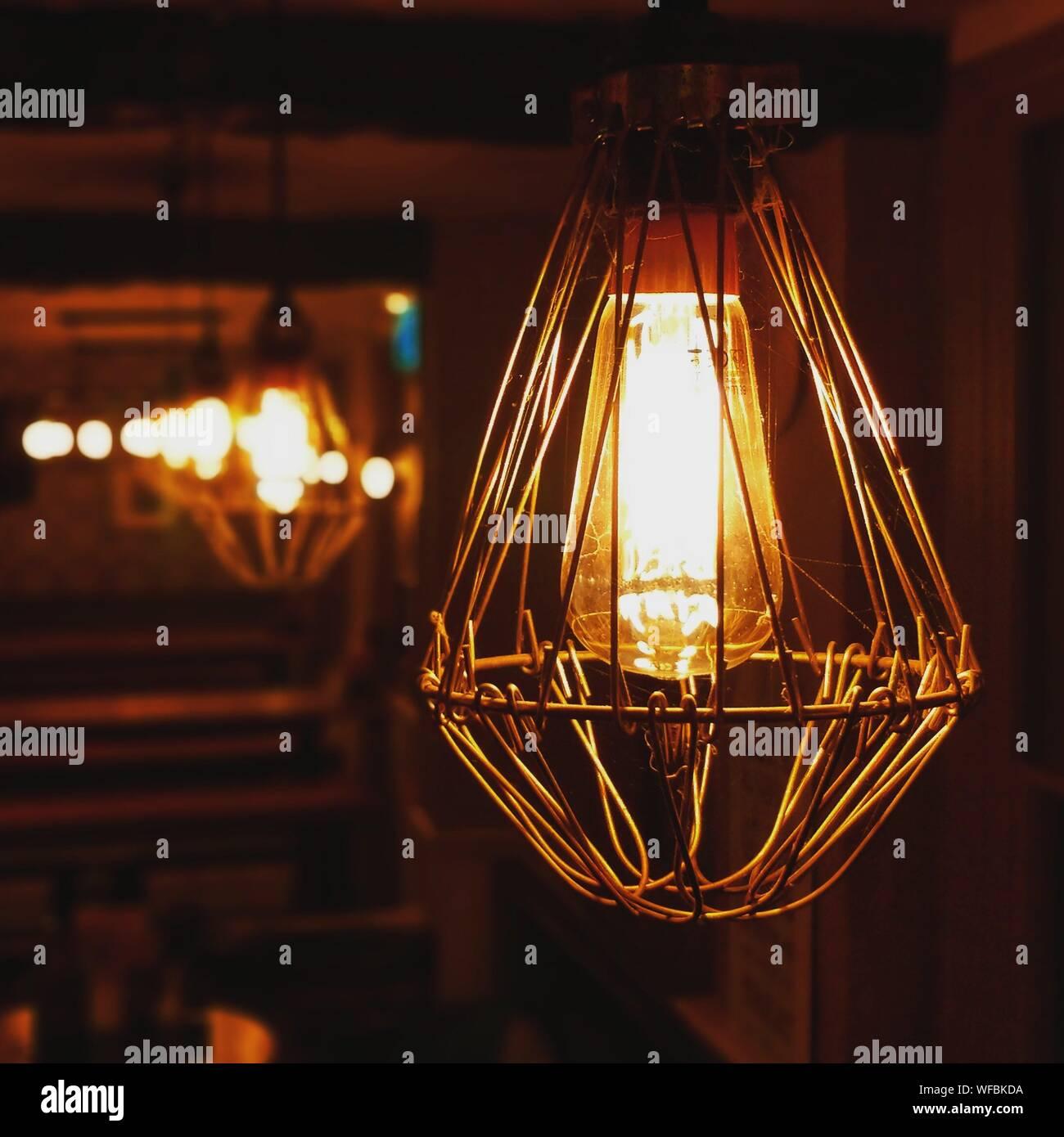 Close-up Of Illuminated Pendant Light In Darkroom Stock Photo