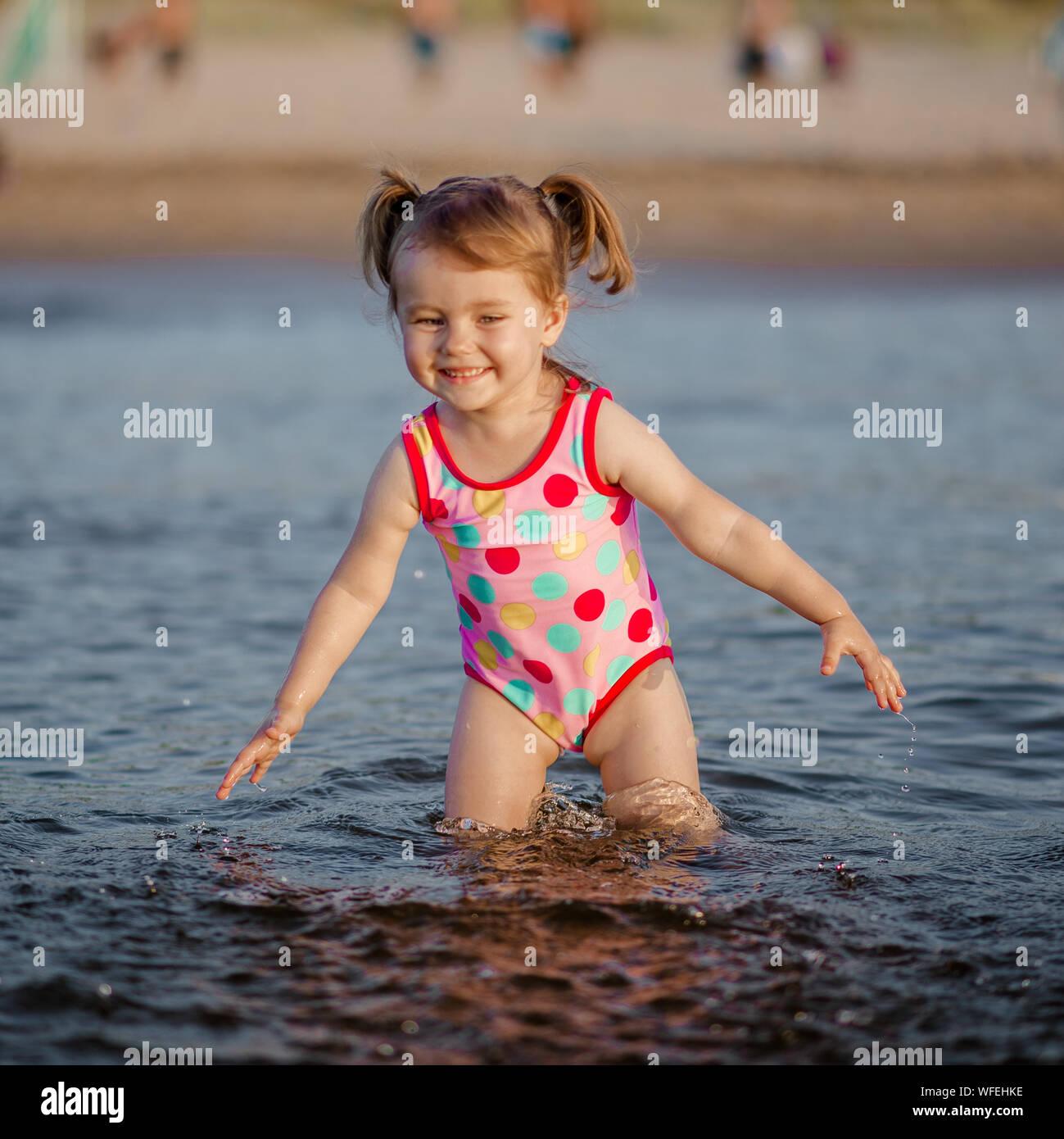 Cute Girl Playing In Sea At Beach Stock Photo 267696562 Alamy