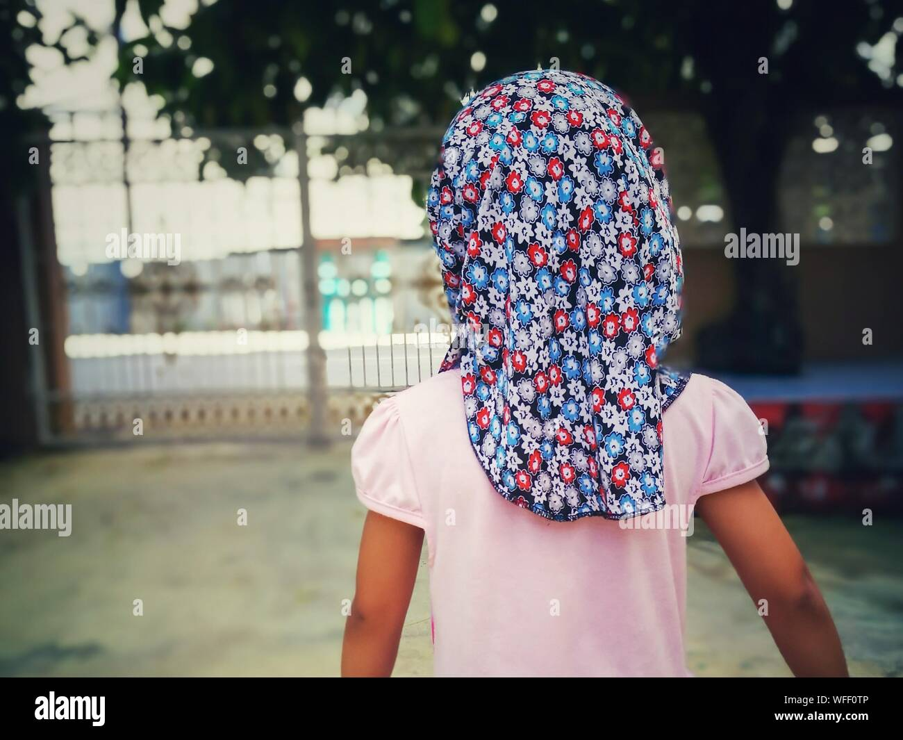 Rear View Of Girl Wearing Floral Headscarf Stock Photo