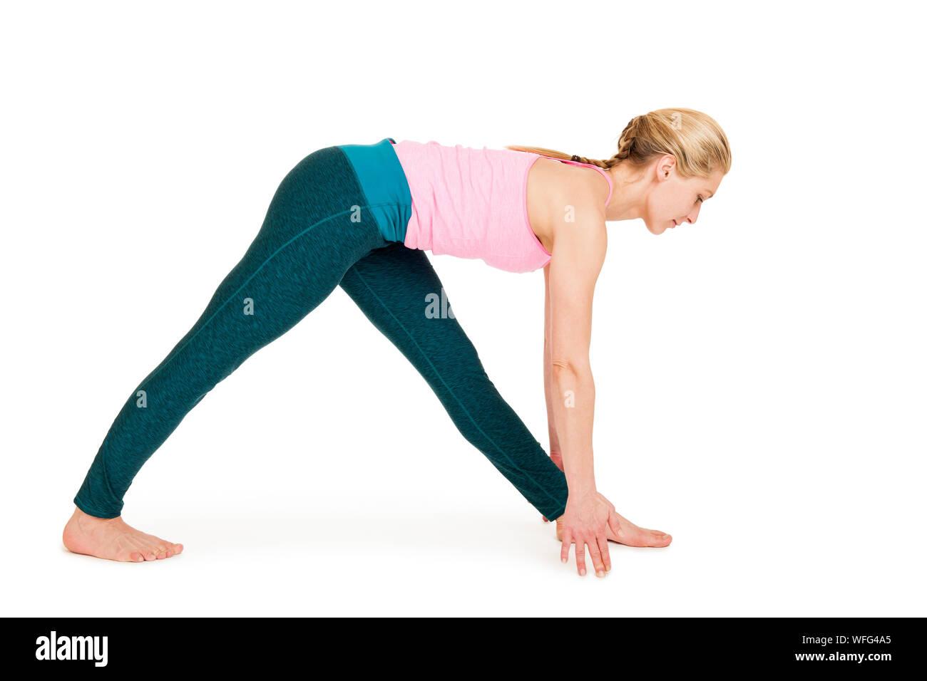 Full Length Of Woman Exercising Against White Background Stock Photo