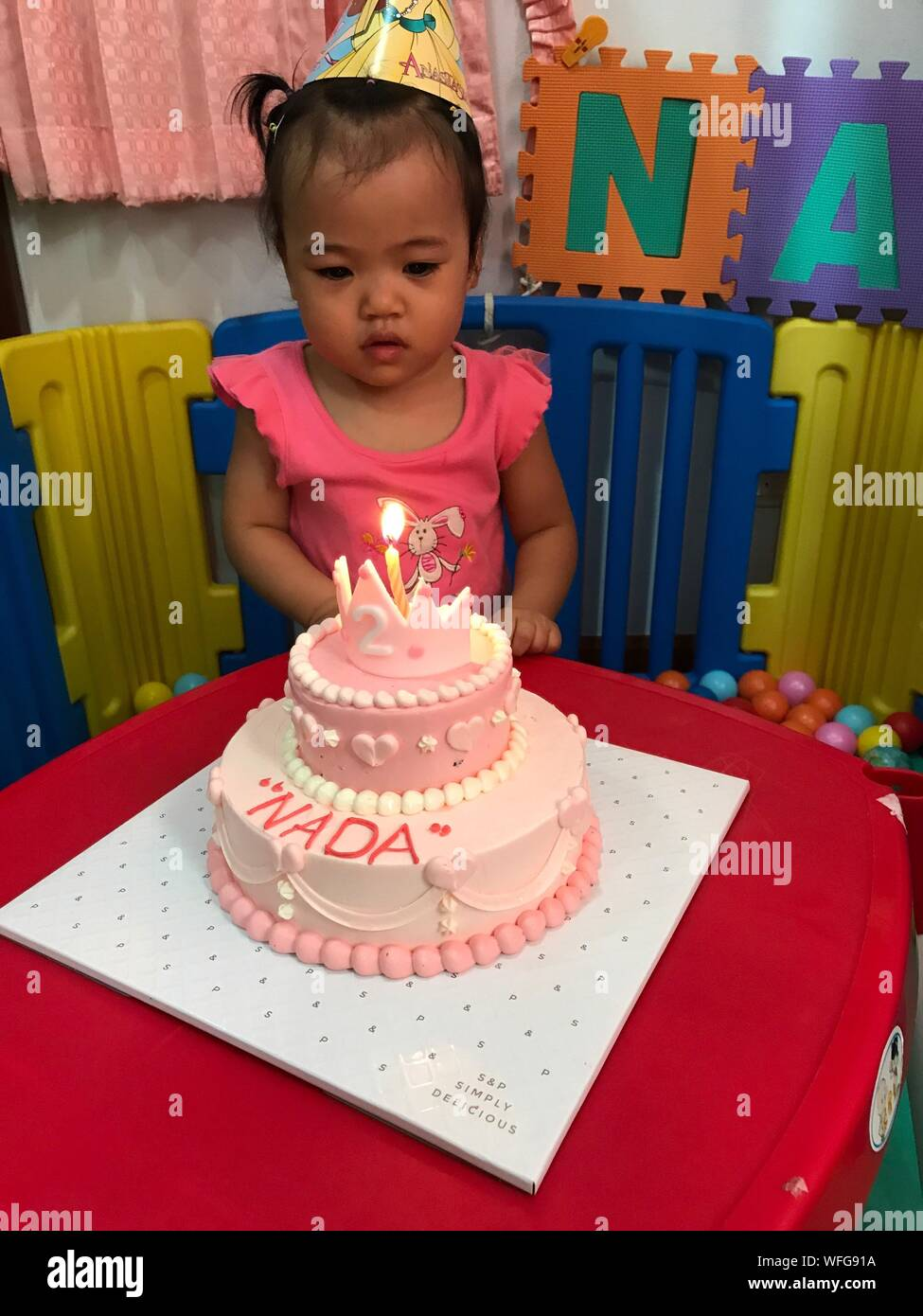 Remarkable Cute Baby Girl Looking At Burning Candle On Birthday Cake Stock Funny Birthday Cards Online Inifofree Goldxyz