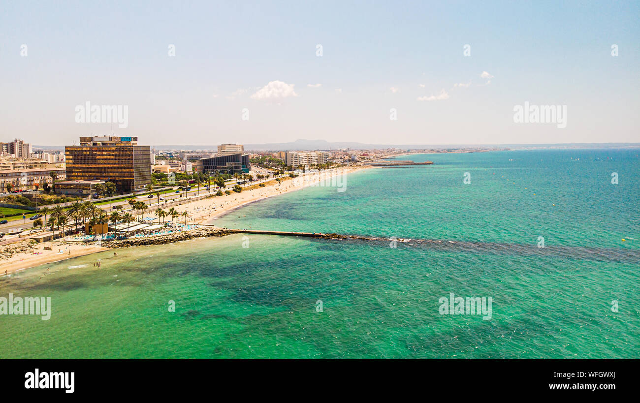 Palma city, Mallorca, Spain - July 03, 2019: People have rest on Palma city beach, aerial drone view. Landscape. Popular summer resort. Stock Photo